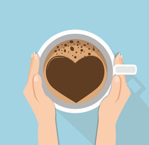 Mão segurando a xícara de café vetor