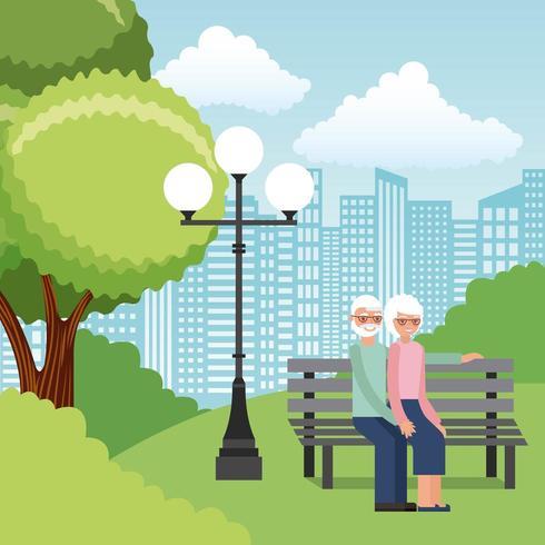 Casal sênior no parque no banco vetor