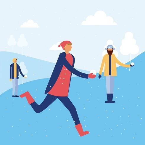 Pessoas felizes brincando na neve vetor