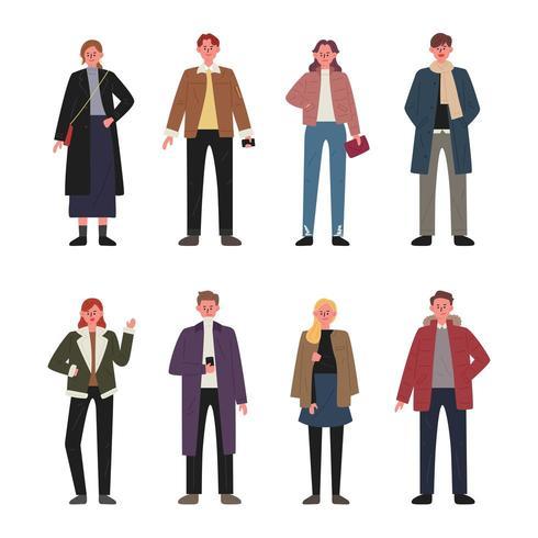 Conjunto de caracteres de homens e mulheres vestindo roupas de outono. vetor