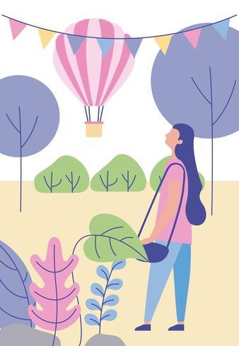 Menina assistindo balão de ar quente vetor
