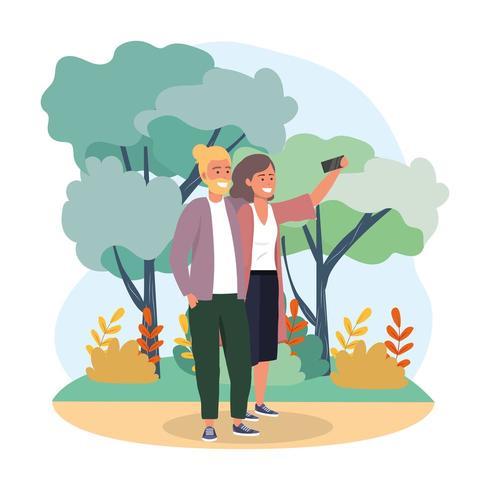 casal mulher e homem com smartphone e plantas vetor