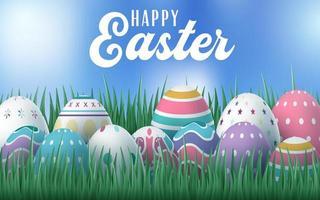 cartão de Páscoa com ovos decorativos na grama vetor