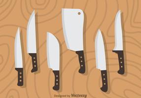 Jogo de faca no vetor de madeira