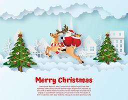 arte de papel origami de Papai Noel e renas na vila