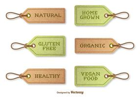 Etiquetas com texturas vetoriais que indicam alimentos orgânicos vetor