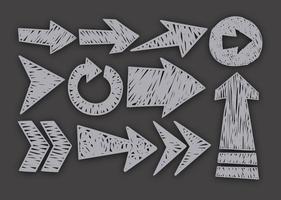 Ícones das setas desenhadas à mão do vetor conjunto