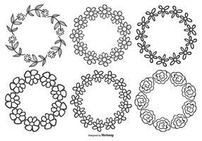 Caixilhos de flores desenhados com mão linda vetor