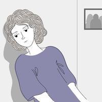 mulher deprimida, inclinando-se contra a parede