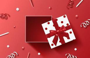 caixa de presente pontilhada aberta com confetes e velas vetor