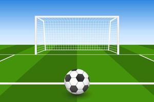bola de futebol na grama na frente do gol