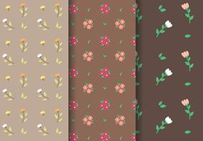 Vector de padrões de tulipas e margaridas