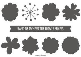 Formas de flores desenhadas à mão vetor