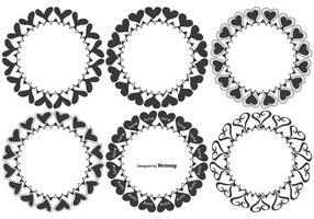 Caixilhos cardíacos com desenhos desenhados à mão vetor
