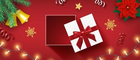 design de comemoração de feliz natal com caixa de presente aberta vetor