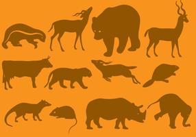 Silhuetas de animais selvagens de laranja vetor