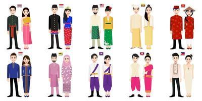 Homens e mulheres asiáticos em trajes tradicionais com bandeiras