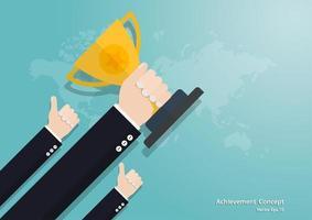 mão de negócios segurando a taça do troféu