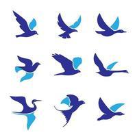 coleção de pássaros voando azuis vetor