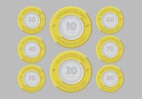 Emblemas de aniversário de ouro e prata vetor