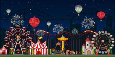 cena de parque de diversões à noite com fogos de artifício vetor