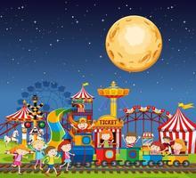 parque de diversões à noite vetor