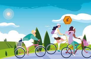 mulheres andando de bicicleta na paisagem vetor