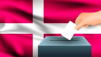 mão colocando cédula na urna com bandeira da Dinamarca
