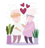 casal de idosos com vasos de plantas