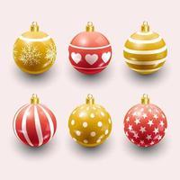 bolas de natal em vermelho e dourado vetor