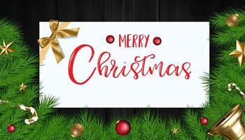 galhos de árvore de natal com enfeites e cartão