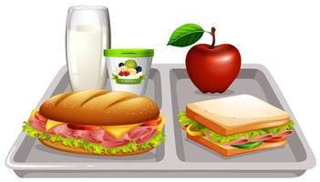 bandeja de comida com leite e sanduíches vetor