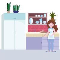 menina com pão assado na cozinha