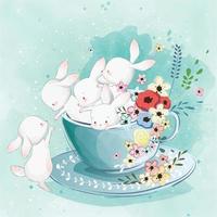 coelhinhos fofos na xícara de chá vetor