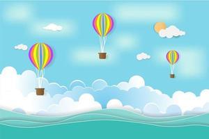 balão de ar quente colorido flutuando sobre o mar vetor