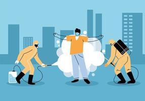 homens usam roupa de proteção, desinfetando uma pessoa