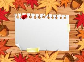 vista superior do papel em branco na mesa com folhas de outono