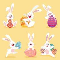 conjunto de coelhinhos da páscoa com ovos decorados vetor