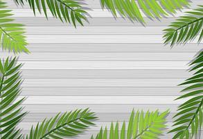 vista superior de pranchas cinzas em branco com moldura de ramos