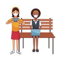 mulheres inter-raciais usando máscaras médicas, usando tecnologia, sentadas na cadeira do parque