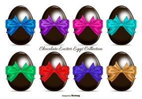 Ovos de Páscoa de chocolate com curvas de presente coloridas
