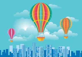 Balão de ar quente colorido e nuvens sobre Vector Skyline