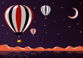 Vôo grátis da noite do balão de ar quente vetor