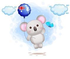 Coala fofo voando com balão com a bandeira da Austrália vetor