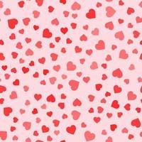 padrão sem emenda com corações em fundo rosa vetor