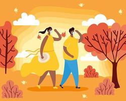 casal com máscaras em uma paisagem de outono