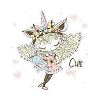 garota com um chapéu de unicórnio com um brinquedo de coelho.