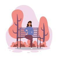 jovem mulher sentada na cadeira do parque vetor
