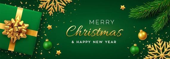 banner de natal verde e dourado com flocos de neve e presente