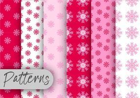 Conjunto de padrões de flocos de neve cor-de-rosa vetor